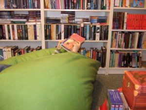 Child reading in Bean Bag